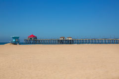 Huntington beach Pier Surf City USA with lifeguard tower Royalty Free Stock Photo
