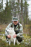 Huntsman and his dog in the hunting grounds Stock Image