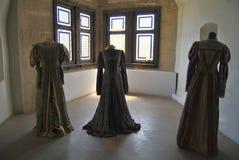 Hunyadi slott - klänningar Fotografering för Bildbyråer