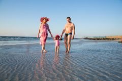 Huppy family on beach in Persian Gulf ,Dubai. Tanning near ocean Royalty Free Stock Photos