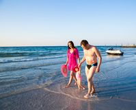 Huppy family on beach in Persian Gulf ,Dubai. Tanning near ocean Stock Image