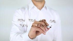 Hur kan din App vända en vinst? Och Att skriva på exponeringsglas Arkivfoto