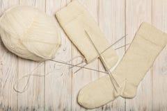 Hur man sticker sockor på fem visare Foto 11 Royaltyfri Bild