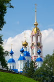 Сhurch and belltower. Orthodox church and belltower against the cloudy sky Royalty Free Stock Images