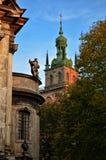 Сhurch in the center of Lviv, Ukraine. Church in the center of Lviv with a statue in the foreground, Ukraine Royalty Free Stock Image