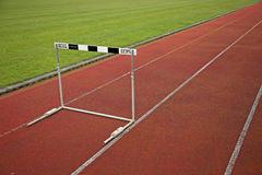 Hurdle. A hurdle on the running track of a stadium Royalty Free Stock Photos