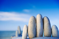 Hurdle. Elongated white gravel on the sea shore Stock Image