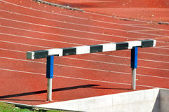 Hurdle in an Athletics Running Track Royalty Free Stock Photos