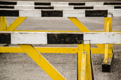 A hurdle race on gray running in stadium track. Old hurdle race Stock Photography