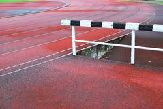 Hurdle on running track Stock Photo
