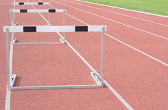 Hurdles. On athletic sports field running track Royalty Free Stock Images