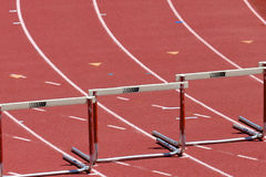 Hurdles. Three track hurdles on a track in each lane Royalty Free Stock Image