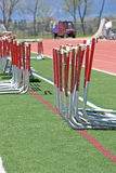 Hurdles alongside the track. Infield, in preparation for a hurdles event at a track and field meet Royalty Free Stock Photo