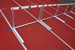 Hurdles Athletic Stadion - 2. Hurdles and red running tracks in a stadion Stock Image