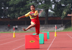 Hurdles. Elementary Students follow hurdles at a stadium in the city of Solo, Central Java, Indonesia Stock Image