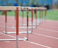 Hurdles lined up on a track, fading focus Royalty Free Stock Photo