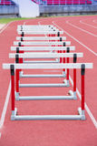 Hurdles on the red running track Royalty Free Stock Images