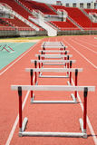 Hurdles on the red running track prepared Royalty Free Stock Image