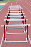Hurdles on the red running track prepared Royalty Free Stock Photo