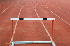 Hurdles on red running tracks Stock Photography