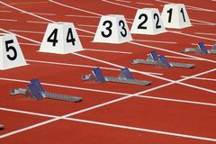 Hurdles run in a stadion stock images