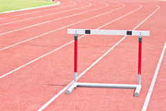 Hurdles on the running track in Stadium Royalty Free Stock Image