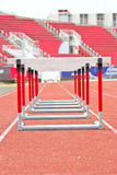 Hurdles on the running track in Stadium Royalty Free Stock Photo