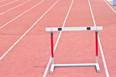 Hurdles on the running track in Stadium Stock Photography