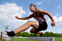 Hurdles sprint. Athlet sprinting over hurdles in track and field Royalty Free Stock Image