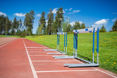Hurdles stacked at the edge of running track Royalty Free Stock Photos