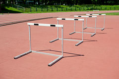 Hurdles on the stadium. Four hurdles on the stadium Stock Photography