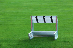 Hurdles. A staple of hurdles piled up on the gras Stock Photography