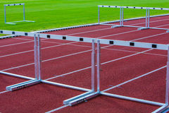 Hurdles on the track Stock Images