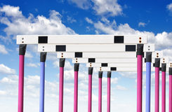 Hurdles for track and field. Row of hurdles for a track and field sprint hurdle race royalty free stock photo