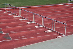 Hurdles on a track and field runway Royalty Free Stock Photo