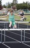 hurdling девушки Стоковая Фотография