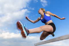Hurdling in track and field. Young female athlete in hurdling in track and field Stock Images