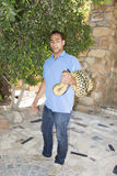 HURGADA, EGYPT - JUNE 23, 2015: Spotted pithon is taken by a man in the street. Safety from reptiles.  Royalty Free Stock Photo