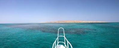 Hurghada beach island ahead of a ship Royalty Free Stock Photography