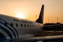 HURGHADA EGYPT 26.05.2018 - Egypt Air Airplane standing to parking position during sunset over its wing.  royalty free stock photo