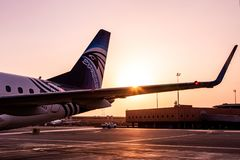 HURGHADA EGYPT 26.05.2018 - Egypt Air Airplane standing to parking position during sunset over its wing.  royalty free stock photos