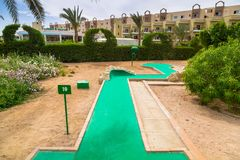 Tropical resort Three Corners Sunny Beach hotel. HURGHADA, EGYPT - APR 9, 2013: Mini golf of Three Corners Sunny Beach in Hurghada on 12 April 2013. Three Royalty Free Stock Photography