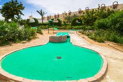 Tropical resort Three Corners Sunny Beach hotel. HURGHADA, EGYPT - APR 9, 2013: Mini golf of Three Corners Sunny Beach in Hurghada on 12 April 2013. Three Stock Images