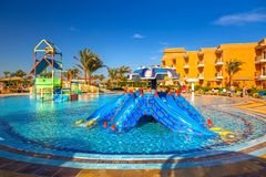 Tropical resort Three Corners Sunny Beach hotel. HURGHADA, EGYPT - APR 9, 2013: Tropical resort Three Corners Sunny Beach in Hurghada on 12 April 2013. Three Royalty Free Stock Image