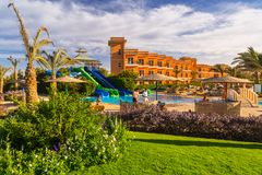 Tropical resort Three Corners Sunny Beach hotel. HURGHADA, EGYPT - APR 9, 2013: Tropical resort Three Corners Sunny Beach in Hurghada on 12 April 2013. Three Stock Photography