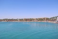 Tropical resort in Egypt. People swimming in sea. Tourists relax on beach. Hurghada/Egypt. 31 July 2018: Tropical resort in Egypt. People swimming in sea stock photos