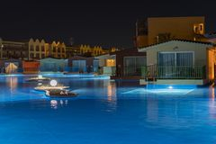 Hurghada, Egypt. November 19 2018 luxury resort with pool at night view. hotel outdoor landscape with pool. Night pool side of. Rich hotel stock images