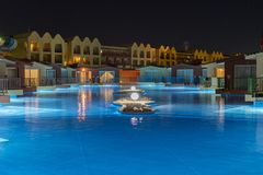 Hurghada, Egypt. November 19 2018 luxury resort with pool at night view. hotel outdoor landscape with pool. Night pool side of. Rich hotel royalty free stock images