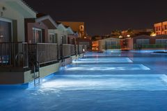 Hurghada, Egypt. November 19 2018 Hurghada, Egypt. November 19 2018 luxury resort with pool at night view. hotel outdoor landscape. With pool. Night pool side royalty free stock images