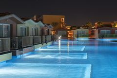 Hurghada, Egypt. November 19 2018 luxury resort with pool at night view. hotel outdoor landscape with pool. Night pool side of. Rich hotel royalty free stock photos